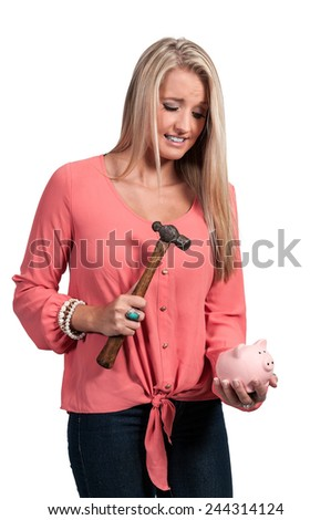 Beautiful woman holding a piggy bank full of money she has saved - stock photo