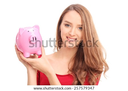 Beautiful woman holding a piggybank isolated on white background