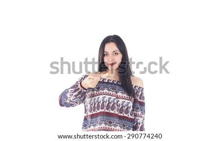 Beautiful woman holding a salmon sushi against a white background - stock photo