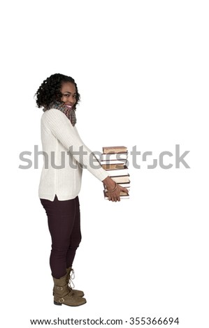 Beautiful woman holding a stack of library books - stock photo
