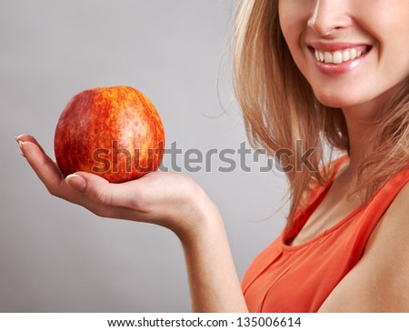Beautiful woman holding apple on her hand - diet concept - stock photo