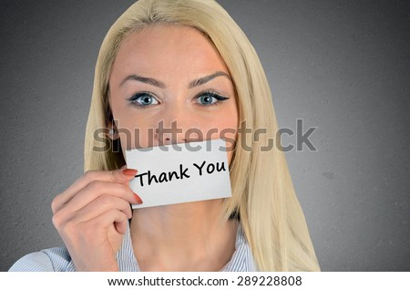 Beautiful woman holding card with Thank you word - stock photo