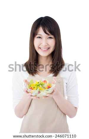 beautiful woman holding glass bowl with salad, isolated on white background