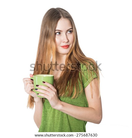 Beautiful woman holding green coffee cup and looking to the side