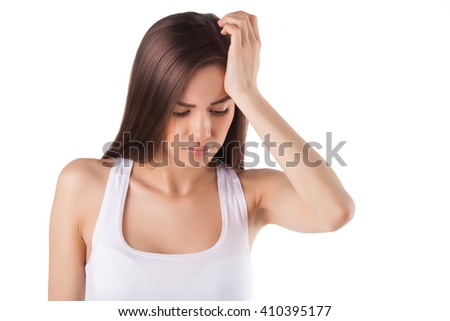 beautiful woman holding her head with her hands. headache. migraine.