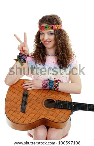 Beautiful woman holding her old guitar in hippie outfit on white background isolated - stock photo