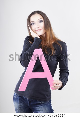 Beautiful woman holding letter A. Sale concept.
