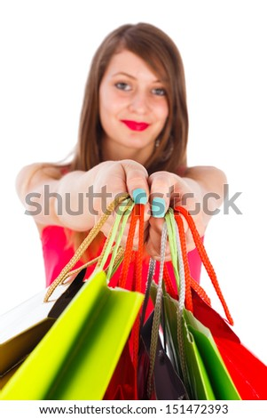 Beautiful woman holding many colorful shopping bags - isolated on white.