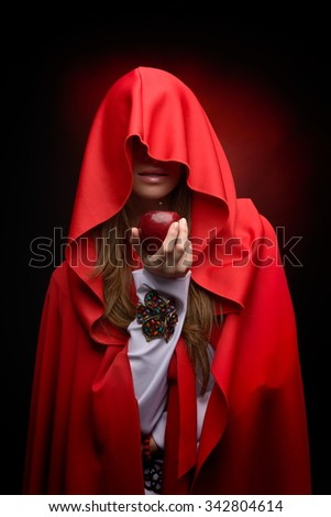 beautiful woman holding red apple in studio - stock photo