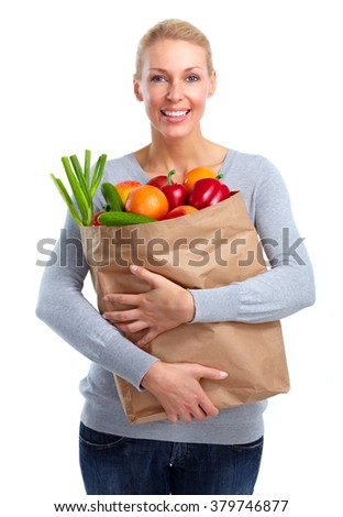 Beautiful woman holding shopping bag with food.