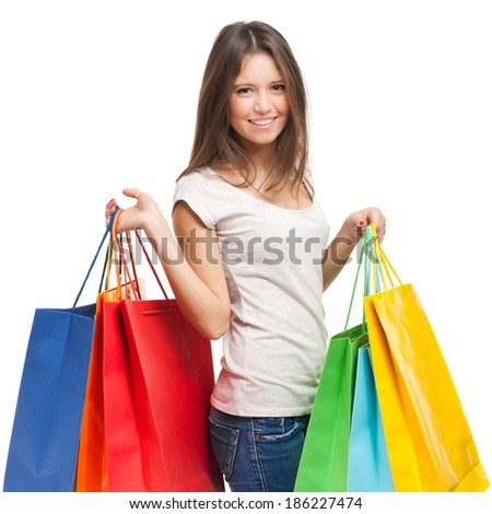 Beautiful woman holding shopping bags isolated on white