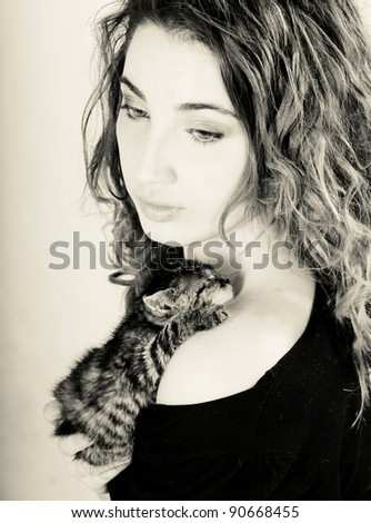 beautiful woman holding small kitten
