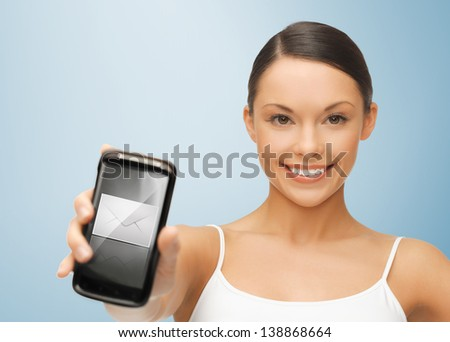 beautiful woman holding smartphone with envelope sign - stock photo