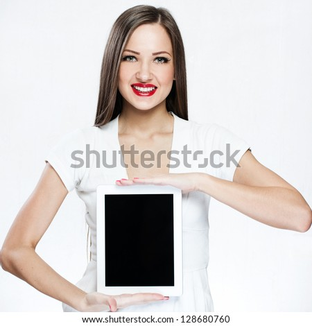 beautiful woman holding tablet pc - stock photo