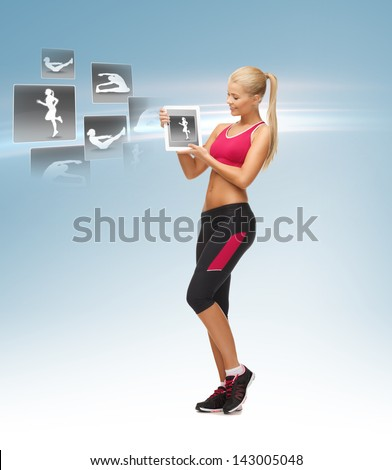beautiful woman holding tablet pc with sport application - stock photo