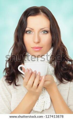 Beautiful woman holding tea cup - stock photo