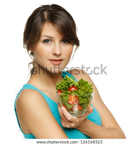 Beautiful woman holding transparent bowl with healthy salad meal, over white