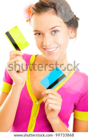 Beautiful woman holding two different credit or discount or membership cards - stock photo