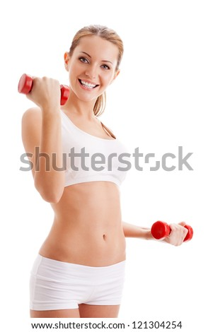 beautiful woman holding two red dumbbells over white