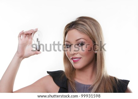 beautiful woman holding up a light bulbs