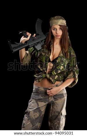 Beautiful woman holding weapon, isolated on black - stock photo
