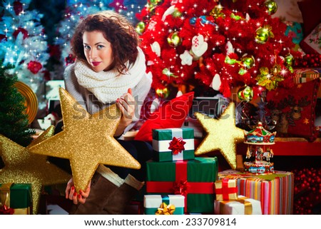 beautiful woman holds in her hand a golden star - stock photo