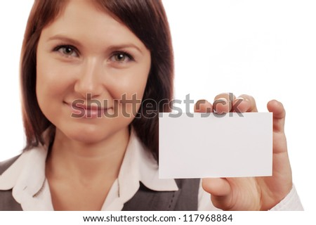 Beautiful woman holds out a business card - stock photo