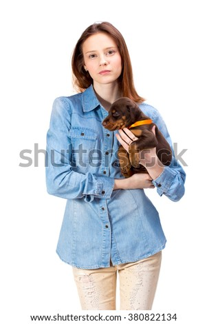 Beautiful woman holds red doberman dog puppy on her hands, isolated on white - stock photo