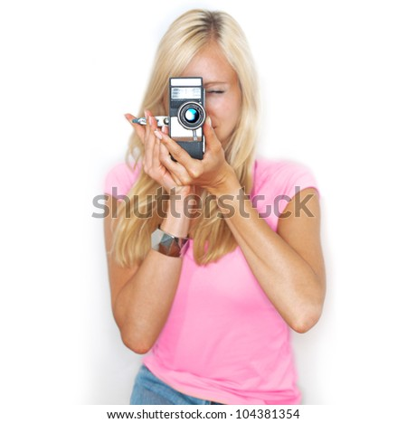 beautiful woman holds vintage film camera - stock photo