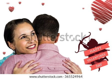Beautiful woman hugging boyfriend against cute valentines message - stock photo