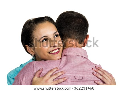 Beautiful woman hugging boyfriend on white background - stock photo