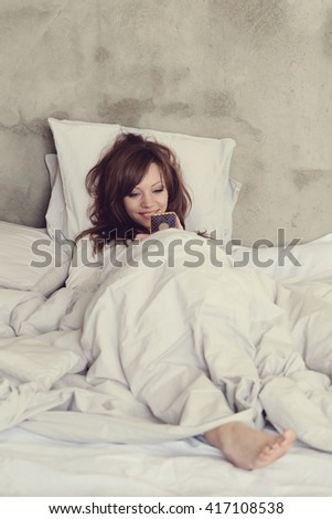 Beautiful woman in a bed