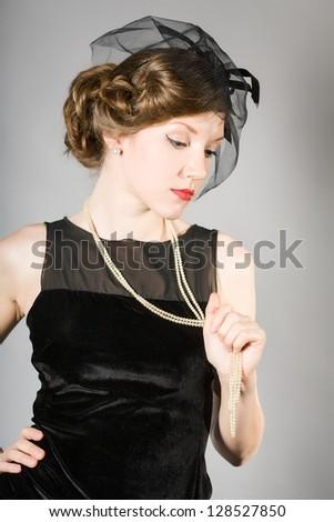 beautiful woman in a black dress retro - stock photo