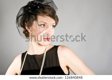 Beautiful woman in a black veil - stock photo