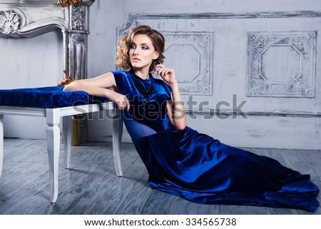 Beautiful woman in a blue dress - stock photo