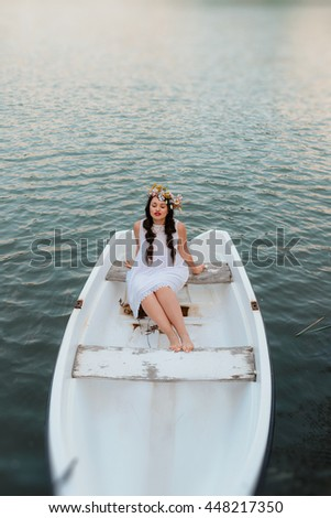 beautiful woman in a boat - stock photo