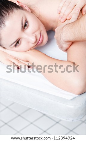 Beautiful woman in a day spa getting deep massage - stock photo