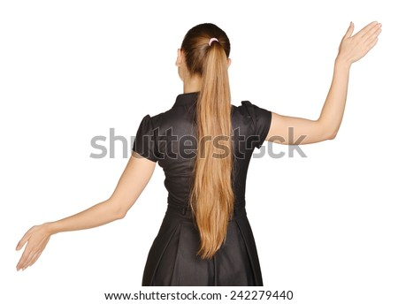 beautiful woman in a dress stands back and raised her arms to the side - stock photo