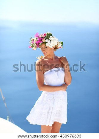 beautiful woman in a dress with a wreath