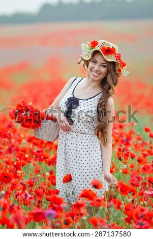 Beautiful woman in a field with flowers
