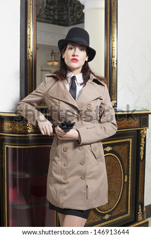 beautiful woman in a hat and with his fist in the background is an old mirror - stock photo