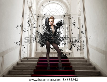 Beautiful woman in a luxury interior - stock photo