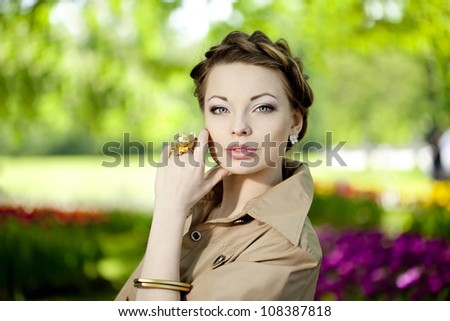 Beautiful woman in a retro style in the city - stock photo