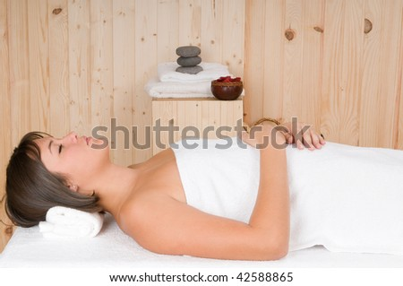 beautiful woman in a sauna or relax massage session