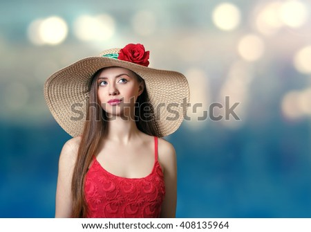 Beautiful woman in a straw hat against the backdrop of the sea . - stock photo