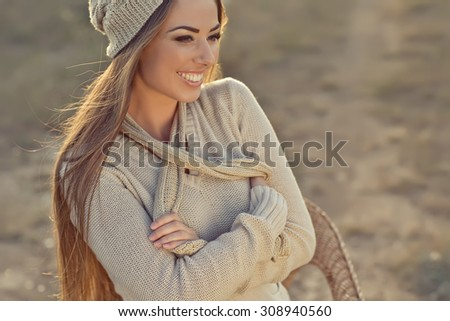 Beautiful woman in a sweater in the fall.Warm light sunset - stock photo
