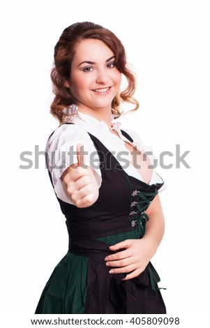 beautiful woman in a  traditional bavarian dirndl with thumb up gesture isolated on white - stock photo