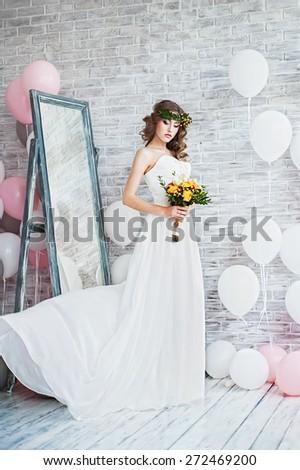 Beautiful woman in a wedding dress - stock photo