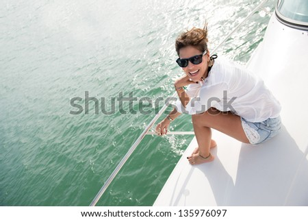 Beautiful woman in a yacht enjoying the summer