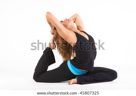 Beautiful woman in a yoga pose on a white background. - stock photo